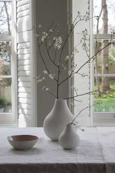 Stylish simplicity. Two words which easily sum up our range of ceramic bud vases. How beautiful does this large white ribbed vase and small ribbed vase look together, styled with branches of blossom for a light and airy look. Perfect for spring! #layerthelook #simplestyling