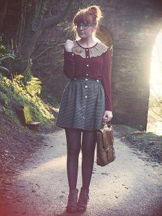 Blouse + skirt. Broach, buttons, maroon. Boots. Bag.
