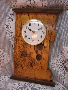Beautiful Wall/ Mantle/Hearth clock made from a hand hewn beam which I reclaimed from a 1830s Ohio barn. This clock is made from American Wormy