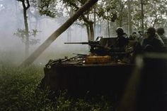 The Cambodian Campaign. Captain Elbridge G Fish II, Commander of F Troop, 2 Sqdn, 11 Armored Cavalry Regiment (the Blackhorse Regiment), US Army, orders a reconnaissance by fire as the Regiment's M-113 Armored Personnel Carriers advance in line at...
