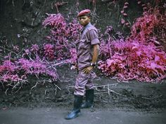 What you're looking is not the result of Photoshop. This incredible collection of photos entitled INFRA from Eastern Congo was shot by 30-year-old photographer Richard Mosse using discontinued Kodak Aerochrome film. Mosse chose this infrared film to intentionally subvert traditional photos taken from the region to help draw attention to an often overlooked conflict.