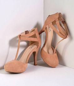 A blushing pair of nude faux suede pumps, these vintage heels boast a sweet 4 heel. A gored and adjustable buckle ankle strap features dual straps and a T-strap vamp for chic flair. A soft cushion insole and back heel zipper makes it easy to wear all day