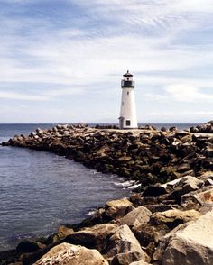 Santa Cruz Breakwater (Walton), CA On June 9, 2002, the new harbor lighthouse was dedicated, and the signal, a green light flashing every four seconds at a focal plane of thirty-six feet, was activated. It is named the Walton Lighthouse, in honor of Mr. Charles Walton's late brother, Derek, who served in the merchant marines and was lost at sea during World War II.