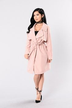 - Available in Taupe and Dusty Pink - Peach Skin Trench Coat - Side Pockets - Waist Tie Belt - Long Sleeve - Fold Over Lapel - Knee Length - 100% Polyester