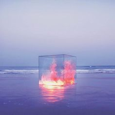 """Fire in a Box by Tanapol Kaewpring  Kaewpring explains, """"These forces of nature have the capacity for great change, growth, and destruction, and yet they are still able to be controlled by humanity. Even they have their limits. These elements combined with their settings represent aspects of psychological freedom. If we are able to think outside the box, to break the glass that surrounds us, perhaps we could achieve true liberation and happiness."""""""