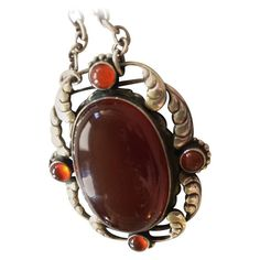 Georg Jensen Sterling Silver Pendant No. 158 with Carnelian | From a unique collection of vintage drop necklaces at https://www.1stdibs.com/jewelry/necklaces/drop-necklaces/
