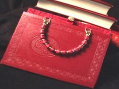 Follow these step-by-step instructions on how to transform an old book into a stylish handbag.