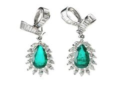Cartier Diamond emerald earrings. estimated diamond weight 7.5ct Emeralds 4.75ct and 4.79ct. Certificated Columbian Signed and Numbered in fitted box.  http://www.luciecampbell.com/earrings/All/1027--/  £ContactUs: richard@luciecampbell.com  Lucie Campbell Jewellers Bond Street London