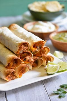 """INGREDIENTS 4 ounces cream cheese, softened 1 398 ml (14oz) can refried beans ½ cup black beans, mashed 1 teaspoon chili powder 1 teaspoon garlic powder 1/2 teaspoon cumin ½ onion, minced finely 1 cup cheddar cheese, shredded 8-10 (6"""" flour tortillas) Flour tortillas"""