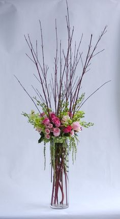 This would be pretty with ll white flowers instead of pink, and if the dogwood were silver. Also add crystal drops near the base of the vase. : Tall Centerpieces with dogwood