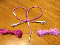 Headphones with Pizazz! These will make them look distinctive and they won't tangle!