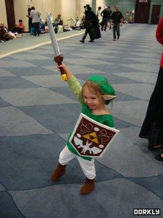 Triumphant child Link cosplay.