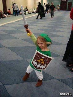 Triumphant child Link cosplay.