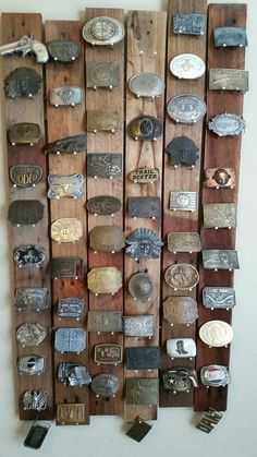 My man made this out of pallet wood, to display his belt buckles