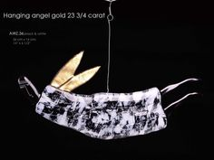 hanging angel 23 3/4 carat 36 cm black & white