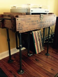 DIY Vinyl record storage Homemade DIY record storage made by Kevin Baucom with industrial pipe and old ammo box.
