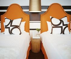 Orange headboards make a splash