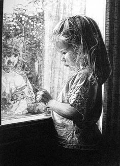 Little girl looking out the window.
