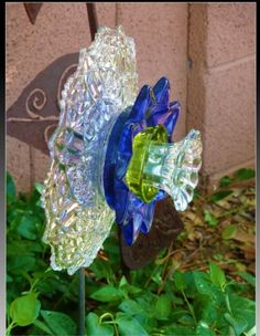 Glass Plate Flower …………………………………………………………. (Photo Courtesy of: http://soozeque.blogspot.com/2012/03/glass-flowers.html)