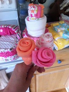 decorations with baby clothes | How to make flowers from baby wash clothes to decorate at baby shower.