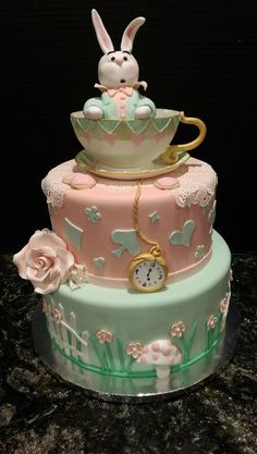 Alice in Wonderland in pastel. Wedding cakes, groom's cake, cupcake weddings, birthday cakes, quinceanera, anniversary, graduation, baby shower, wedding shower, and any celebration.