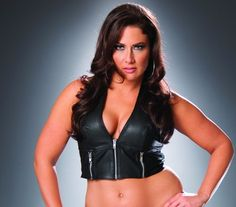 Leather zip front halter top with zipper detail. Leather back