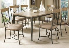 Hillsdale Charleston Rectangle X-Back 7-Piece Dining Set by Hillsdale. $1099.91. Belongs to Charleston Collection by Hillsdale. Rustic Desert Tan wood finish. Dark Grey metal frame. Wood Rectangle Table Top. The table and chairs in this 7-piece metal and wood dining set incorporate traditional details with contemporary touches. The rectangle table with a desert tan wood top and dark gray metal straight legs can easily accommodate 6. The six x-back chairs featur...