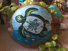Hand painted coconut shell Coconut Shell Crafts, Painted Rocks, Hand Painted, Seaside Art, Painted Shells, Turtle Painting, Driftwood Crafts, Tropical Art, Shell Art