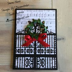 Christmas Card using the Gate Thinlits die, Merry Music Specialty Designer Paper and Boxwood Wreath Embellishments. Rhinestone coloured in with red sharpie pen.