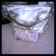 Coach handbag with matching wallet Gold tone handbag with 2 short straps and one long one that can be removed. Matching wallet with plenty of card space. Mint condition. Coach Bags