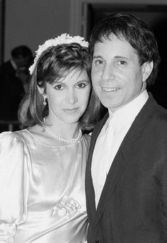 Carrie Fisher and Paul Simon. I can't look at this without thinking of C.F. in The Blues Brothers! Loved her in it!
