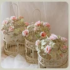 Resultat d'imatges de jaulas decoradas con flores naturales