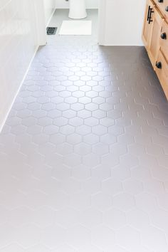 Before you rip out your ugly bathroom tile, you should read this! We changed our bathroom tile for $150 bucks and it looks amazing! Painting Bathroom Walls, Painted Bathroom Floors, Wood Floor Bathroom, Painting Tile Floors, Best Tiles For Bathroom, Tile For Bathroom Floor, Floor Grout, Ceramic Tile Bathrooms, Bathroom Ideas