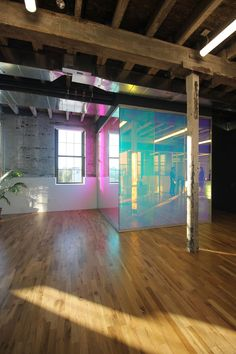 Dichroic film finishes at glass walls inside adaptive reuse building.