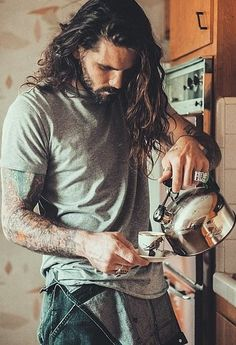 Coffee gives us a reason to get out of bed in the morning. Hot guys are a pretty good reason, too. Put them together and you've got the perfect recipe, and that's just what the men and coffee Instagram account has done for us. We've already been blessed with the hot guys reading Instagram, so the discovery of a collection of handsome men sexily making and drinking our favorite beverage is the icing on the cake — or should we say, the whipped cream on our Frappuccinos? Admire these pictures…