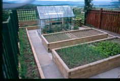 Raised herb / veg beds with patio surround www.WoodBlocX.co.uk