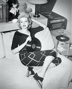 """American actress Kathleen Hugues, famous for her role in the cult movie """"It Came From Outer Space"""", enjoying her records at home. Vinyl Record Art, Vintage Vinyl Records, Pin Up, Lps, Jeane Manson, Vinyl Junkies, Record Players, Up Girl, Vintage Photos"""