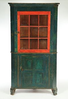 CORNER CUPBOARD.   Lehigh County, Pennsylvania, early 19th century, cherry, pine and poplar. Two-piece, the upper section with nine panes and molded mullions; the lower section with a paneled door, all resting on ogee bracket feet. Retains its original blue and red paint. Minor repairs to the cornice. 81h. 46w. 20d.,#Repin By:Pinterest++ for iPad#