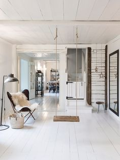 Indoor swing in a charming family home in the Finnish countryside - Photo Carina Olander / styling Anna truelsen. Lantliv.