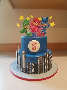 PJ Masks city scape cake with hand cut and detailed character toppers.