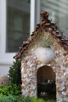 Do you believe in #Fairies? If so, build them a shell house! #shellgarden #shellcrafts For more miniature coastal garden ideas, click here: http://www.completely-coastal.com/2012/04/miniature-gardens-with-beach-theme-in.html