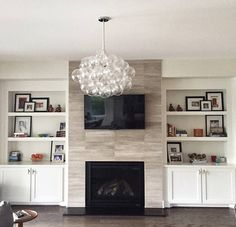 Bring in the airy lightness of a summer sky to warm your home throughout the seasons. Comprised of thirty crystal clear large glass bubbles surrounded by a host of our smaller bubbles, the XL Bubble Chandelier is perfect for a space that deserves light an Built In Around Fireplace, Fireplace Tv Wall, Fireplace Built Ins, Farmhouse Fireplace, Fireplace Remodel, Fireplace Design, Fireplace Bookshelves, Basement Fireplace, Fireplace Ideas