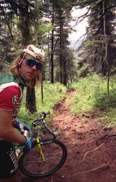 John Tomac in 7-11 kit, with long hair, fishnet helmet and on an mtb. #totalWin