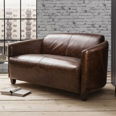 Escort Leather 2 Seater Sofa. The Escort sofa is a classic leather tub chair style sofa made for two Manufactured using the finest top grain leather making this sofa extra comfortable whilst being stylish. #sofa #leather #2seater #livingroom