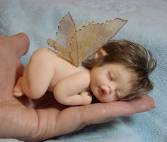 """""""Fascination"""" by doll artist Galina Makovskaya, from Penza, Russia. This miniature baby doll is made from polymer clay & is about 4 inches in length."""