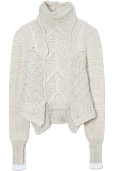 I love this sweater... it's Pre-Fall '11 Céline.  I bet I can reverse-engineer it... someday.