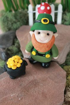 This listing is for one (1) hand sculpted polymer clay gnome/leprechaun in a festive St. Pattys Day outfit. He is approximately 2.5 tall and very