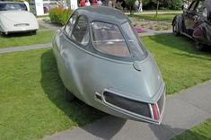 Panhard et Levassor Dynavia concept car (1946) [back] with dramatically aerodynamic droplet bodywork reflecting aviation styling delivering fuel consumption of less than 3.5 litres per 100 km (67.2 mpg). A powerful central spotlight replaced headlights supplemented by  experimental dipped beam lights.