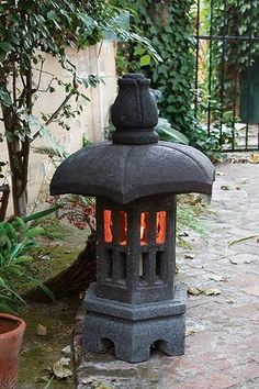 Pagoda garden lanterns, each piece is hand carved out of solid lava stone. Japanese Garden Lanterns, Japanese Stone Lanterns, Japanese Garden Plants, Asian Garden, Japanese Garden Design, Indoor Zen Garden, Japanese Garden Landscape, Balinese Garden, Chinese Lanterns