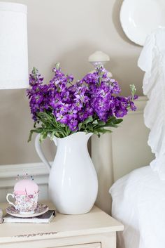 Exciting News and the Back Story - Cedar Hill Farmhouse | White Ironstone Pitcher with Purple Flowers from Garden look perfect for this bedroom nightstand.